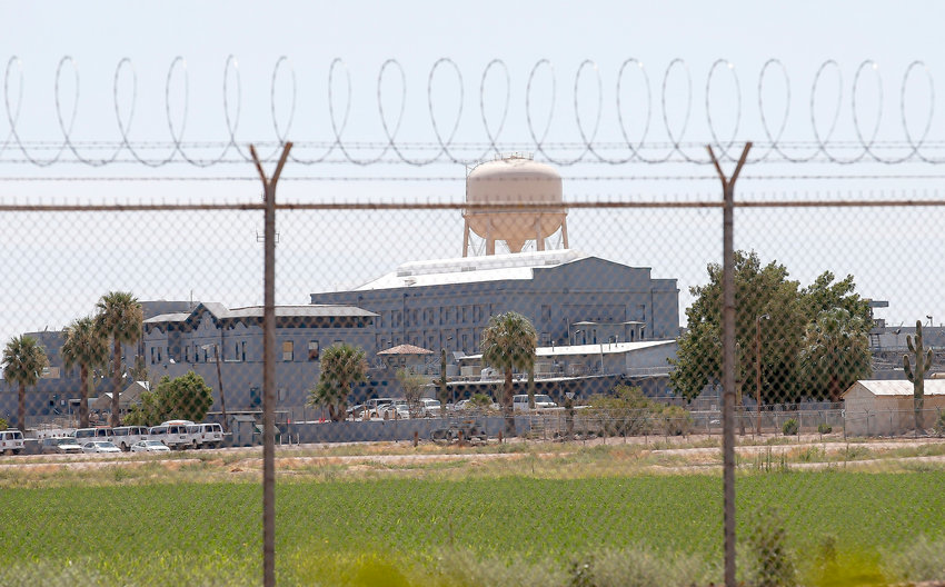 This July 23, 2014 file photo shows a state prison in Florence. State prison officials have been ordered to revise their policy of what inmates can — and cannot — see and read.