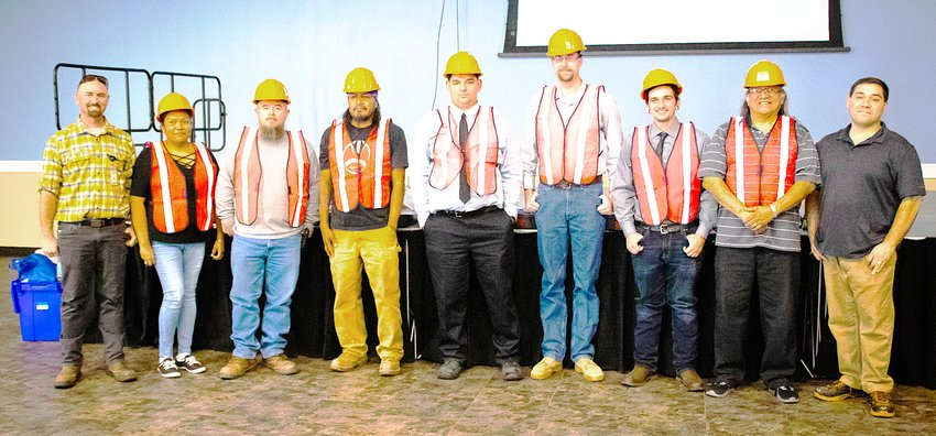 Graduates line up at the Oct. 11 certificate ceremony for the Arizona Department of Transportation's new full-time Construction Academy program in Camp Verde. The pre-apprenticeship program prepares workers across the state for highway construction jobs. [Courtesy of ADOT]