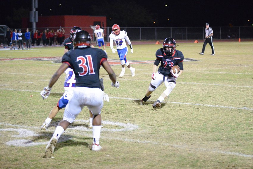 Liberty junior safety Shane Pitts gathers himself after intercepting a pass Nov. 15 against Mesa Mountain View. The Lions won the 6A football quarterfinal 45-28.