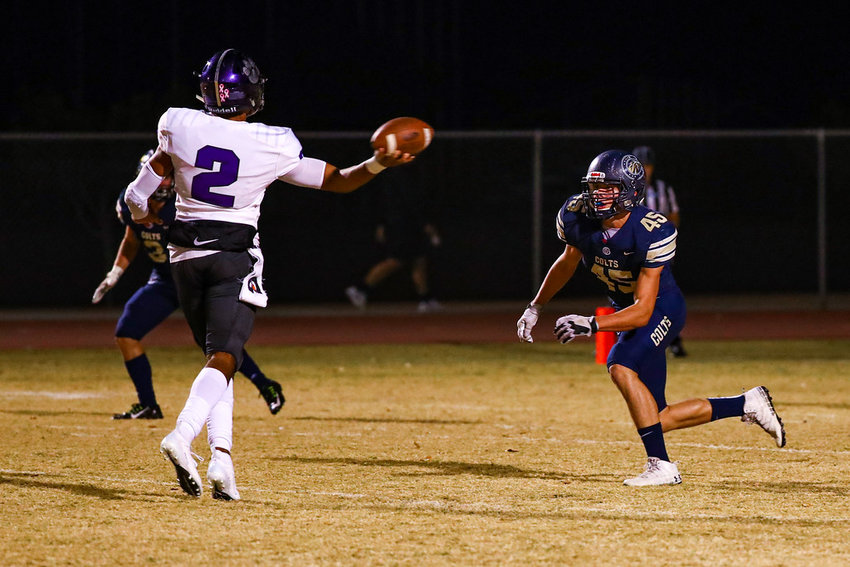 Millennium senior quarterback Jalan Early tries to sidearm a pass against Casteel during a 5A playoff quarterfinal Nov. 15 at Casteel High School in Queen Creek.