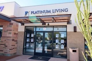 Platinum Living Realty opens new office location at The Summit shopping center.