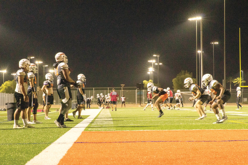 OUAZ football players run drills on Spirit Field during an evening practice. The AstroTurf field opened in October of 2017.