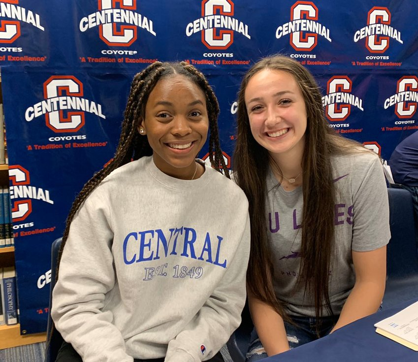 Centennial volleyball seniors Nyjha Marcelin, left, and Ashley Lifgren signed to play volleyball at Central Connecticut State University and Grand Canyon University, respectively, during a ceremony Nov. 12 at the Peoria school.