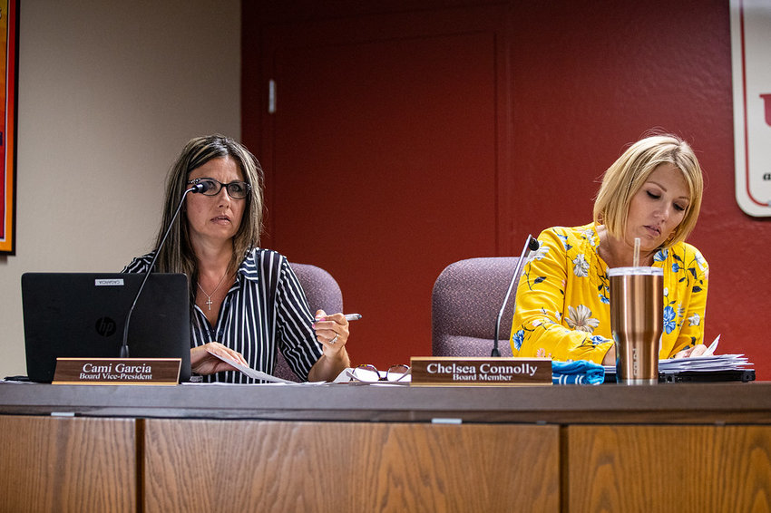 Cami Garcia and Chelsea Connolly, members of the Apache Junction Unified School District Governing Board, at a recent meeting.