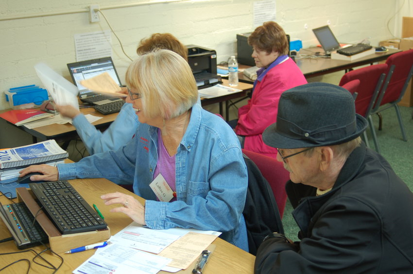 Sun City Community Assistance Network volunteers help clients with their taxes.