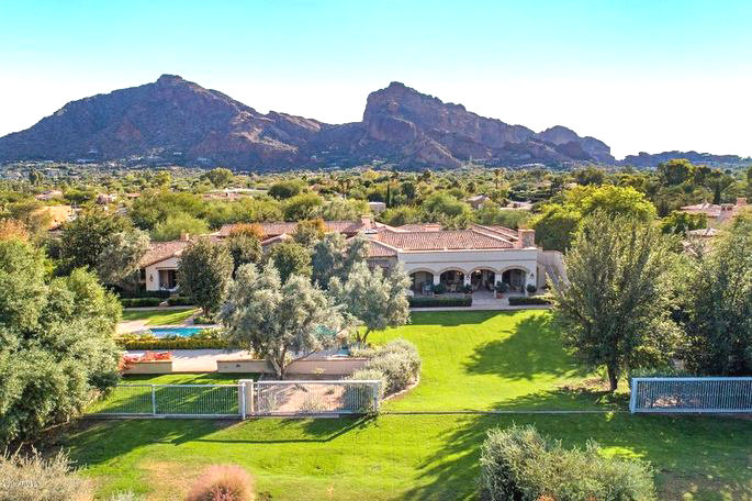 Gov. Doug Ducey is offering up his 10,200 square foot home on two acres in Paradise Valley, hoping to get $8.75 million for the property.
