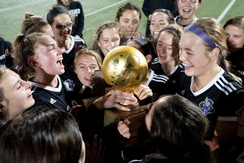 The Northwest Christian soccer team celebrates after their 3A Championship game against Anthem Prep on Friday, Feb. 15 2019 at Williams Field High School in Gilbert.