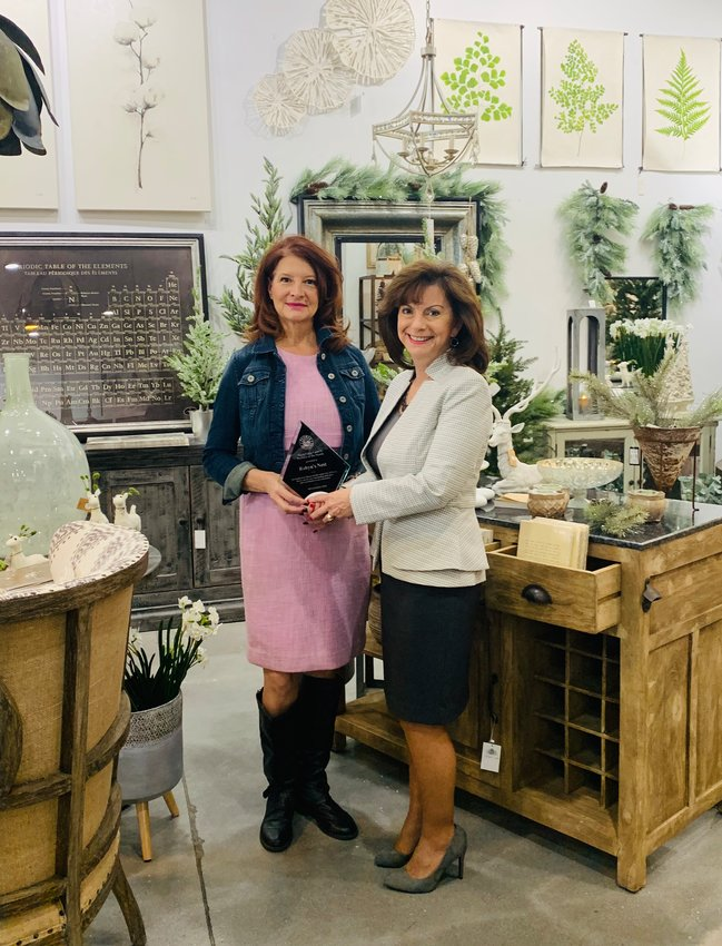 Retailer Robyn's Nest received the mayor's award for November. Mayor Cathy Carlat (right) is joined by owner Robyn Halperin.