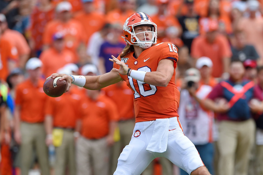 FILE - In this Oct. 12, 2019, file photo, Clemson's Trevor Lawrence throws a pass during the first half of an NCAA college football game against Florida State, in Clemson, S.C. Lawrence has not thrown an interception in his last four games to go with 13 touchdown passes. Clemson meets the Ohio State Buckeyes in the Fiesta Bowl Dec. 28, 2019.