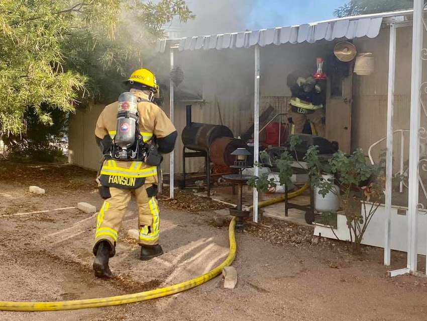 Superstition Fire and Medical District officials at a fire in Apache Junction.
