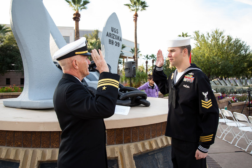 Master at Arms 1st Class Petty Officer Christopher Kurz took the oath of enlistment from Lt. Cmdr. Phillip Fortnam at the USS Arizona Memorial at the Wesley Bolin Memorial Plaza in Phoenix. on Dec. 7, 2019,  which commemorates the 78th anniversary of the Japanese attack on Pearl Harbor, Hawaii.