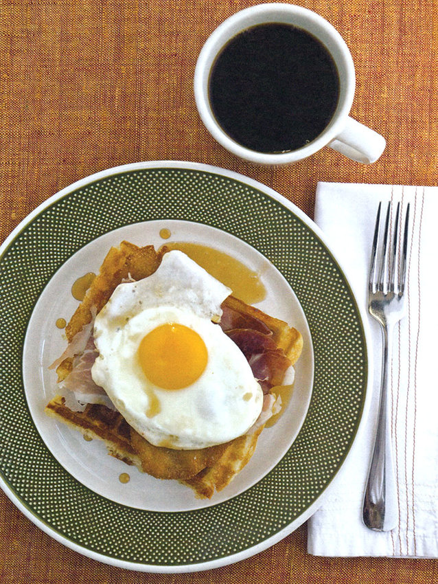 Cheddar waffles go good with pork schnitzel, country ham, and sunny-side-up egg.