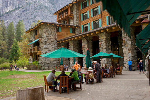 FILE - In this Oct. 24, 2015, file photo, people dine outside the Ahwahnee hotel in Yosemite National Park, Calif. Federal health officials are inspecting Yosemite National Park's food service areas after at least a dozen people have fallen ill with stomach issues. The National Park Service and the U.S. Public Health Service told the San Francisco Chronicle they launched an investigation after employees and visitors reported the problems in January 2020. (AP Photo/Ben Margot, File)