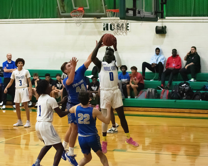Paradise Honors senior forward Jerry Iliya goes up for a layup against the defense of Valley Christian junior center Chandler Carter (#44) during a Feb. 11 game at St. Mary's High School in Phoenix.