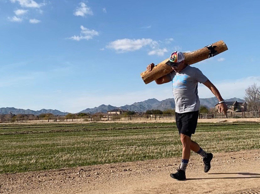 Koby McGrew is running in the Rock 'n' Roll Marathon in Tempe on Sunday while carrying a 45-plus-pound log.