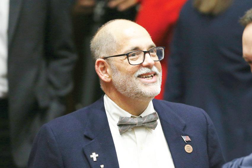 In this Monday, Jan. 13, 2020 photo, Sen. David Livingston, R-Peoria, smiles as he walks into the House of Representatives chamber on the opening day of the legislative session to listen to the State of the State speech at the Capitol in Phoenix. The Arizona lawmaker wants the state's voters to approve a measure that would ensure the families of police, firefighters and other public safety officers get at least $1 million if their loved one dies on the job.