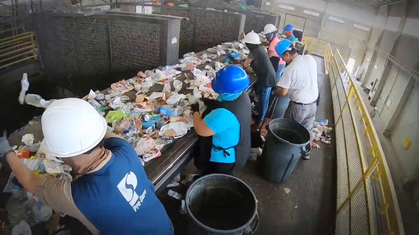 City of Glendale workers separate nonrecyclable material from recyclable material as it passes on a conveyer belt at Glendale's recycling facility, 11480 W. Glendale Ave. [Submitted photo/City of Glendale]