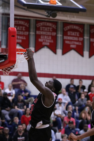 Ironwood senior David Teibo throws down a dunk in the final seconds of the Eagles' 69-55 victory at Centennial on Jan. 31.