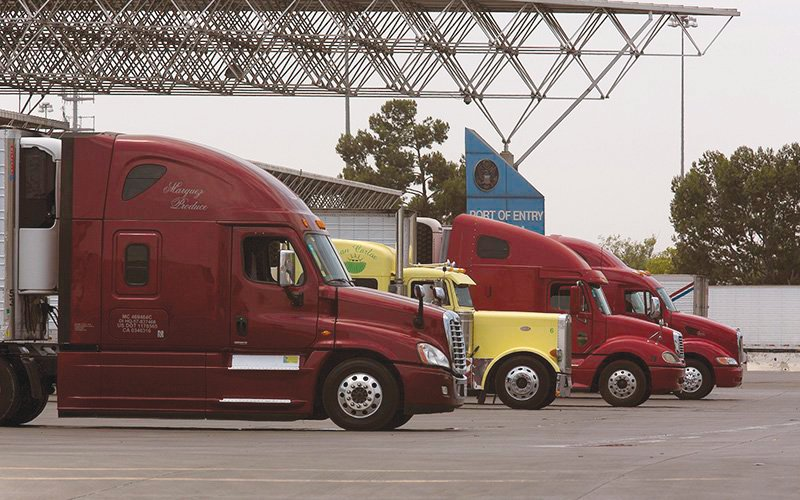 Trucks wait to enter the U.S. from Mexico at the Otay Mesa, California, Port of Entry.  [Glenn Fawcett/U.S. Customs and Border Protection]