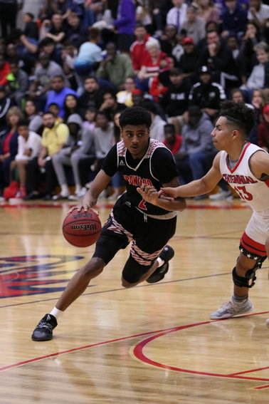 Ironwood senior guard Dominic Gonzalez turns the corner on his drive against Centennial senior guard Jojo Rincon during a Jan. 31 at Centennial.  Gonzalez is the Eagles all-time leader in points, assists, steals and wins.