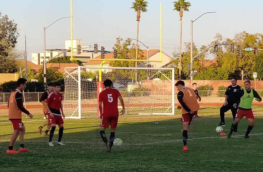 The Ironwood boys soccer team warms up before its 5A playoff quarterfinal win over Phoenix Horizon Feb. 19 at Ironwood High School in Glendale.