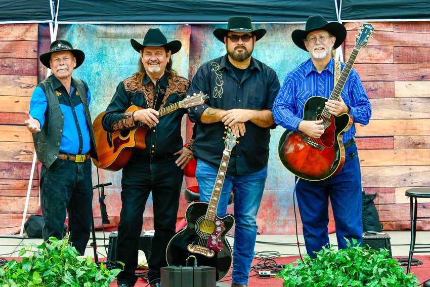 The Magnificent Seven: 4 Guys, 3 Guitars. [Submitted photo]