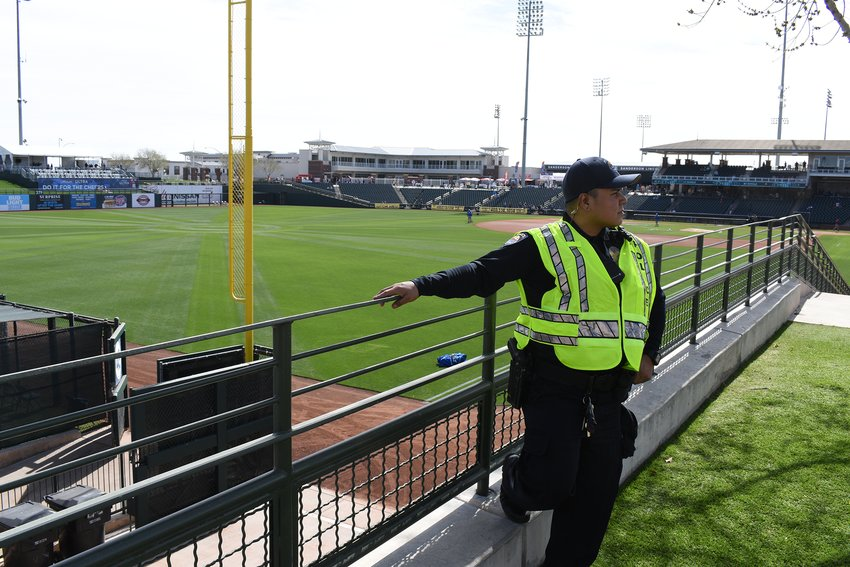 Phil Ortega of the Surprise Police Department looks over the crowd prior to the season opening spring training game Feb. 21 between the Texas Rangers and Kansas City Royals.