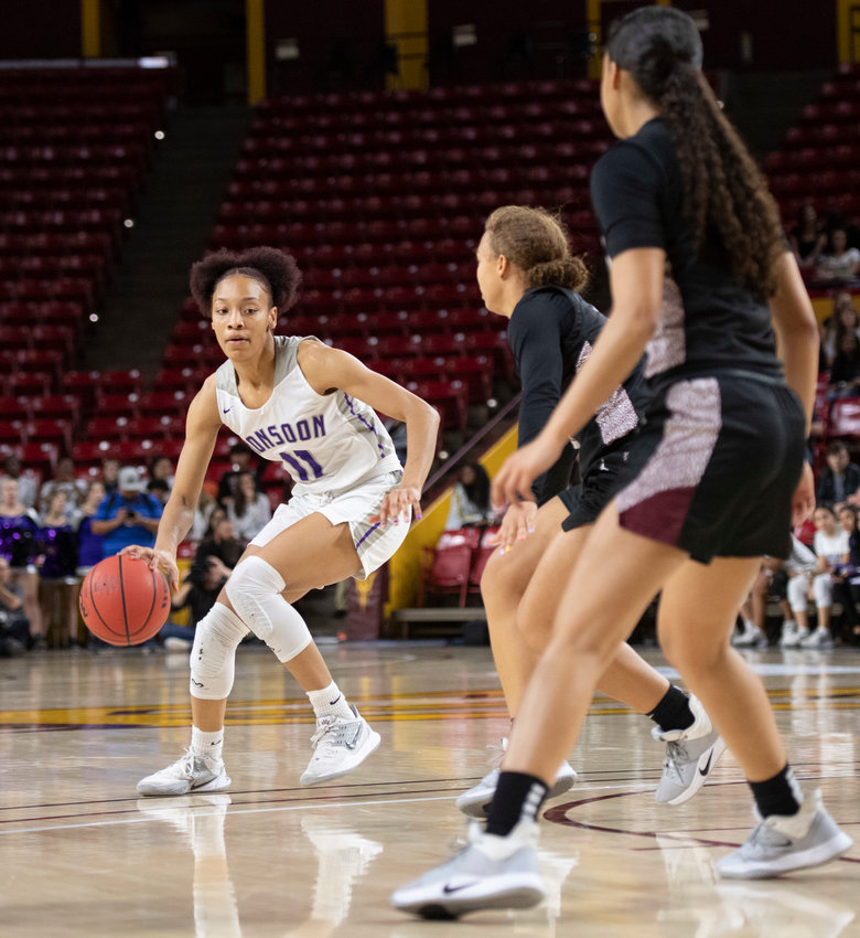 Valley Vista junior forward Marisa Davis prepares to drive as Chandler Hamilton defenders line up to stop her during the 6A girls basketball state final March 3 at Desert Financial Arena in Tempe.