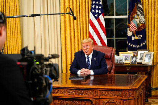 President Donald Trump speaks in an address to the nation from the Oval Office at the White House about the coronavirus Wednesday, March, 11, 2020, in Washington. (Doug Mills/The New York Times via AP, Pool)
