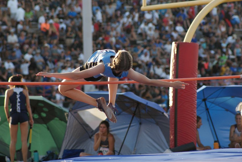 Deer Valley High School junior Sara Roskelley clears the high jump bar during the 2019 state track and field meet in Mesa. Track is one of the four sports the Skyhawks senior has earned a varsity letter in.