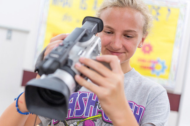 Rhylen Buchberger works on setting up the camera in order to shoot her team's commercial during class at Countryside Elementary.