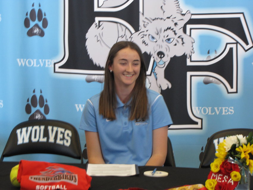 Estrella Foothills senior Racheal Jesionowski smiles as she signs to play softball for Mesa Community College next season. She pitches for the Wolves.