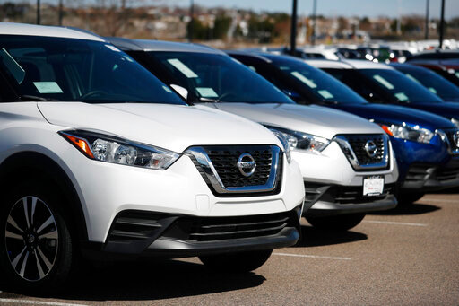 FILE - In this Sunday, March 22, 2020, file photograph, a row of unsold 2020 Kicks SUVs sit at a Nissan dealership in Highlands Ranch, Colo. With the country effectively shut down and the economy upended by the coronavirus pandemic, buying a car is likely a low priority on people's minds. A number of online shopping resources make it easier than ever to research, view inventory, and even initiate a sale from the safety of your own home. (AP Photo/David Zalubowski, File)
