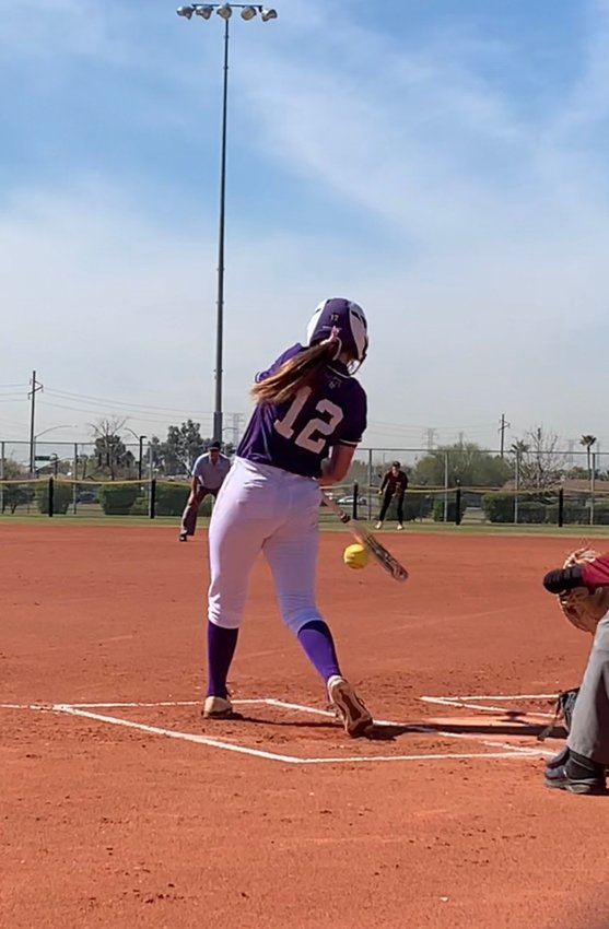 Sunrise Mountain senior utility player Reyna Gil is about to connect with a pitch during the Mustangs preseason tournament in February at Pioneer Park in Peoria. Gil signed to play at Paradise Valley Community College but may have to face a second straight season wiped out by COVID-19.