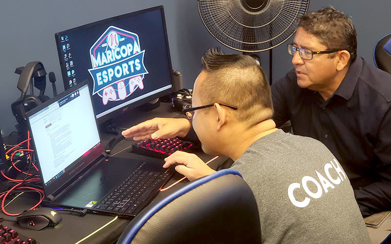 Maricopa Esports League Coach Jack Ngan, left, discusses registration numbers Sept. 11, 2019, ahead of its October 2019 launch.