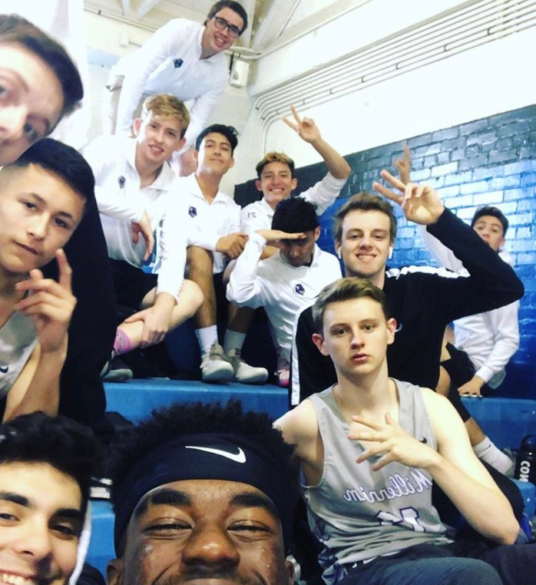 Millennium boys volleyball players smile for the camera during a break in the Wolf Howl Invitational at Chandler High School in March. The Tigers were led by 10 seniors and a top contender for the 5A state title.