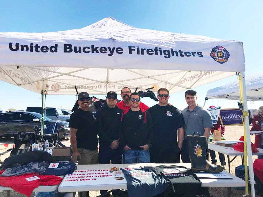 Members of the United Buckeye Firefighter Charities sold T-shirts and other items at the Buckeye Air Fair in February to raise money for its community programs. The organization is one of 82 area nonprofits awarded grants by the West Valley Mavericks Foundation.