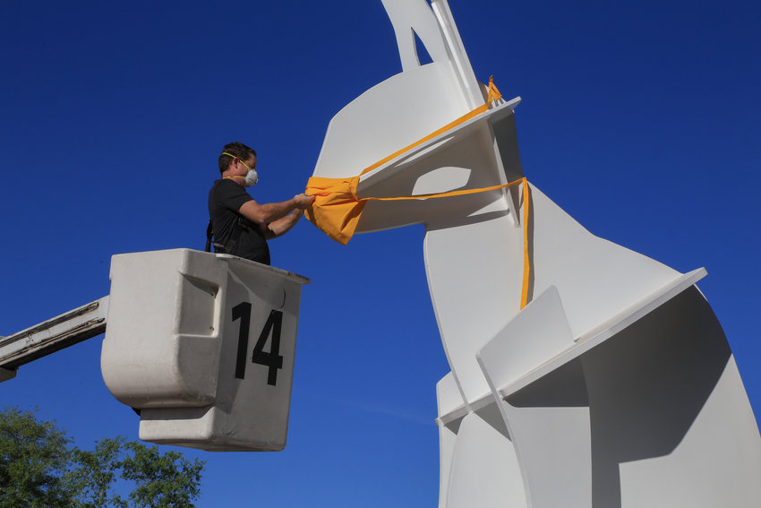 The City of Scottsdale, Scottsdale Public Art, One-Eyed Jack statue creator John Randall Nelson collaborated to add a face mask to the popular public art sculpture.