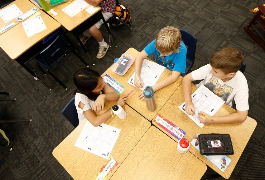 Students get back to work in their third grade class at Oakwood Elementary School, Friday, May 4, 2018, in Peoria, Arizona.