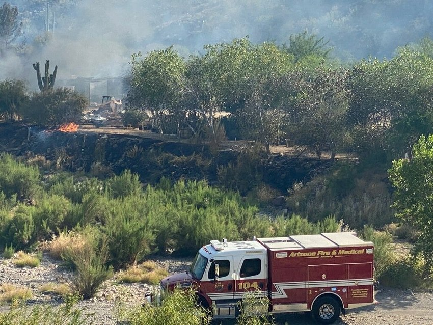 The Arizona Fire and Medical Authority personnel assisted with structure protection at the Ocotillo Fire in Cave Creek May 30. Multiple agencies assisted on the incident while protecting several structures under hazardous wildfire conditions.
