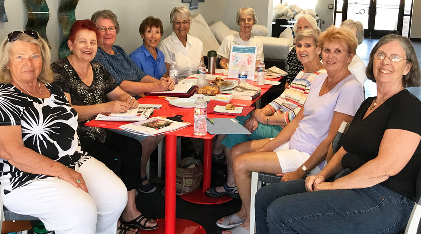 The AAUW Northwest Valley Branch ladies discus the upcoming food drive, which will take place Saturday, July 4.