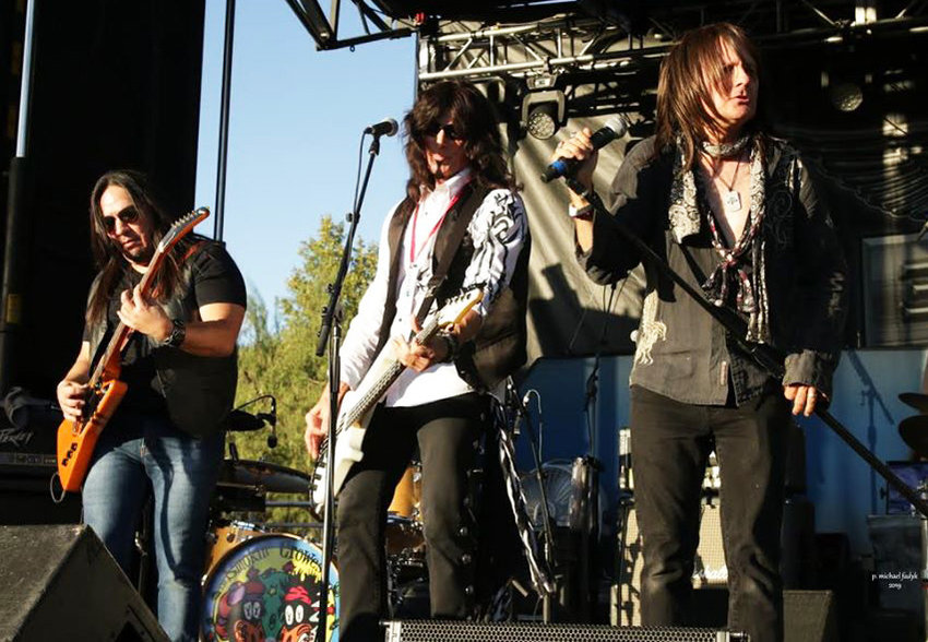 Gary Carrillo, Mikki Seven and Mark Johnson as The Smokin' Crowes perform July 4th in Surprise.