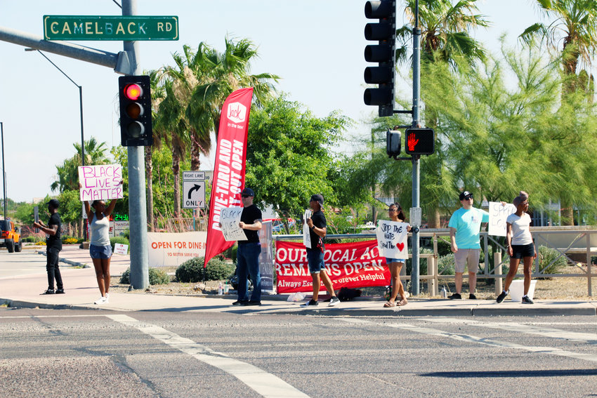 Residents gather June 6, 2020, at Camelback and Litchfield roads in Litchfield Park for a peaceful protest.