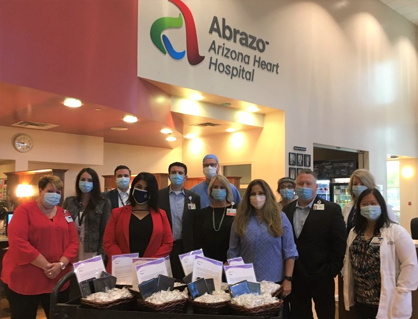 """Representatives of the """"Caring for Our Caregivers"""" initiative visited Abrazo Arizona Heart Hospital to donate tablets with mediation videos for health care workers' stress relief during the coronavirus pandemic."""