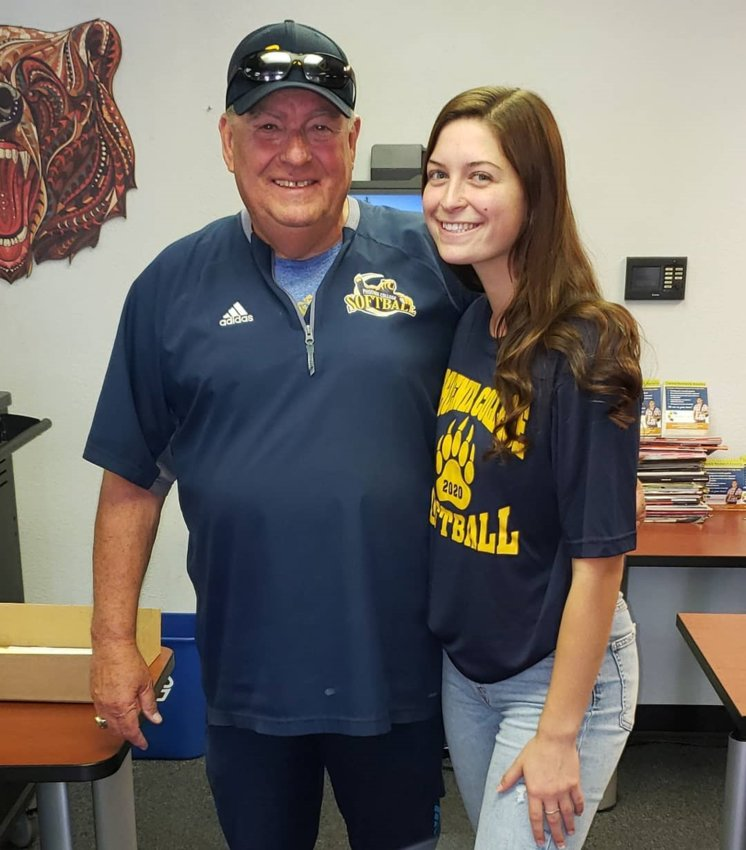 Then-Valley Vista senior softball player Josette Orion smiles with Hall of Fame Phoenix College softball coach Heinz Mueller after signing with the Bears in November 2019. Maricopa County Community Colleges are considering canceling the 2020-21 athletic season and will have community forums July 8 and 9.