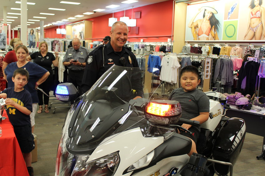 Officer Jason Judd with a friend at a National Night Out, when local Target stores partner with police departments to promote community involvement and crime prevention.