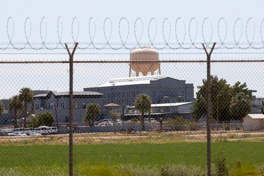 In this July 23, 2014, file photo, a state prison stands behind a fence in Florence.