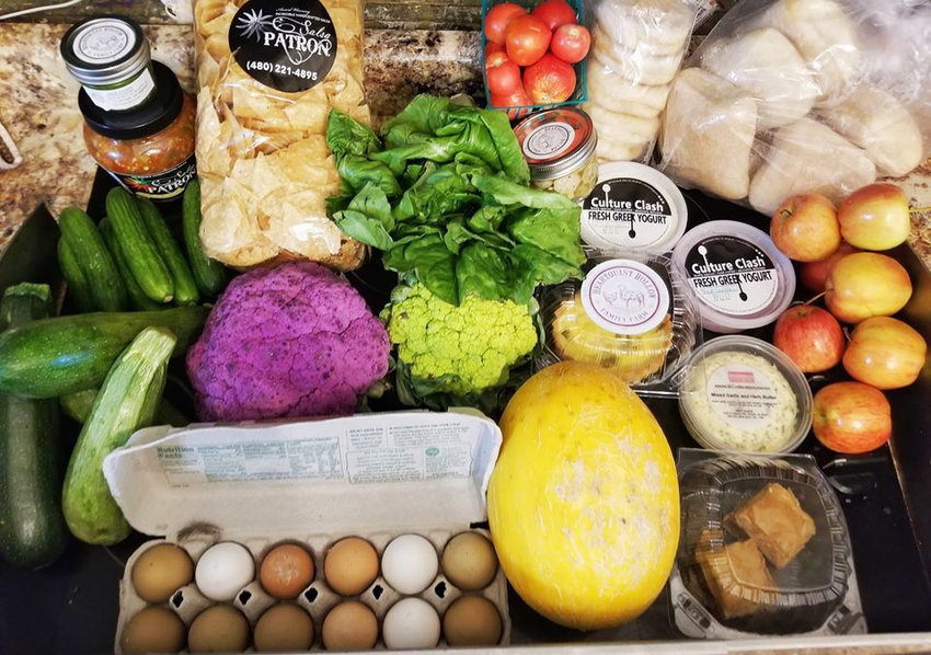 This haul of fresh produce, farm fresh eggs, mixed herb butter, salsa, chips, pesto, pickled okra, Chile relleno tart, greek yogurt, pistachio baklava, english muffins and ciabatta rolls was available at Momma's Organic Market in July in Glendale.