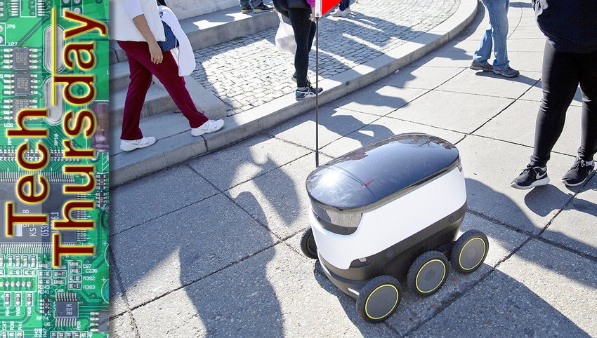 In this Feb. 20, 2017, file photo, a six-wheeled ground delivery robot shares the sidewalk with pedestrians along DuPont Circle in Washington, D.C. San Francisco-based Starship Technologies has since deployed the dinner-delivering drones on college campuses across the country, including at Northern Arizona University in Flagstaff.