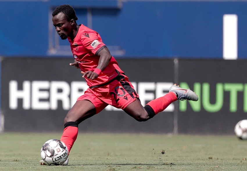Phoenix Rising's Solomon Asante kicks the ball downfield against LA Galaxy 2 on Wednesday afternoon.
